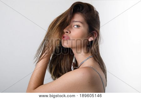 Young Pretty Girl Setting Her Hair