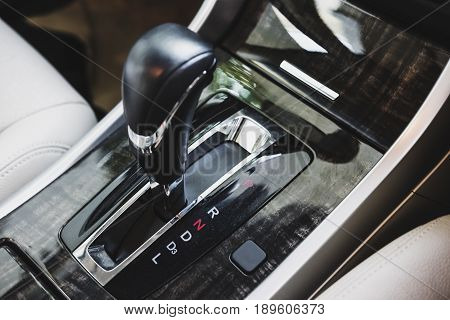 Close-up gear stick shifting to
