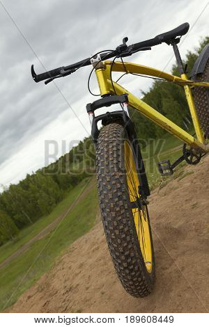 Steering of Fat bike at summer countryside - dirty bicycle, horizontal, horizontal photo