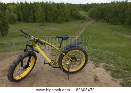 Fat bike at summer countryside - dirty bicycle, horizontal, horizontal photo