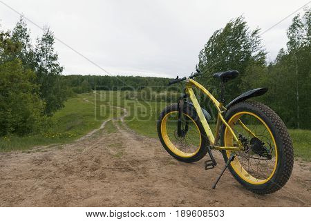 Fat bike - rear view of dirty bicycle at summer countryside, horizontal, horizontal photo
