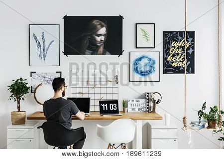 Man working on his laptop in modern home office