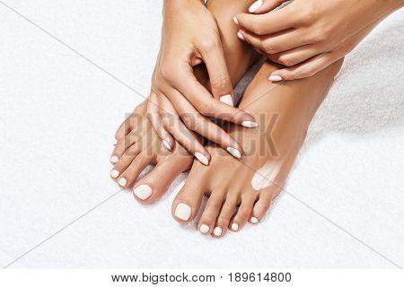 Beautiful female feet with moisturizing cream. Close-up. Legs care concept.