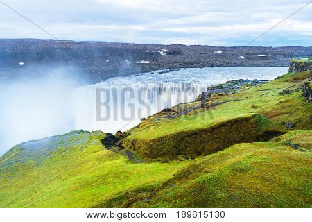 Dettifoss Waterfall, Iceland, Europe. Summer landscape with river and canyon. Famous Tourist Attraction. Cloudy morning. Beauty in nature