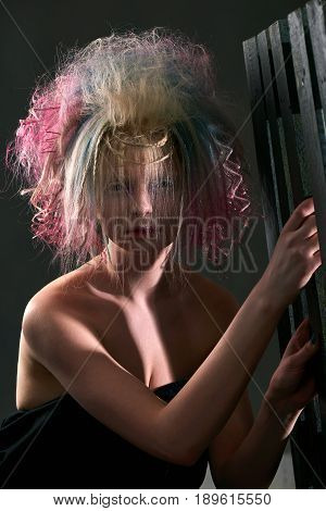 Portrait of a beautiful female albino with dyed hair professional hair coloring