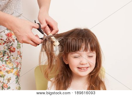 Mother Cuts Daughter's Hair At Home