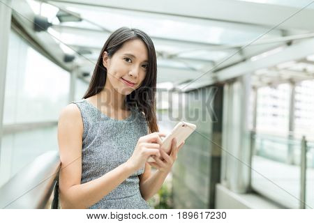 Business woman working on mobile phone
