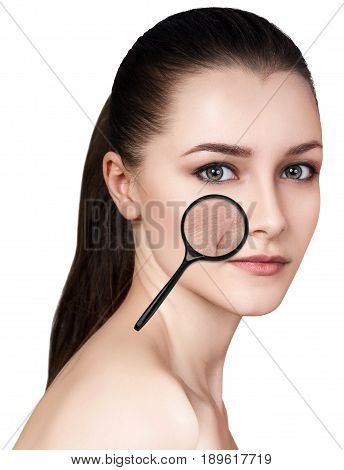 Woman with magnifying glass shows age-related mimic wrincles on her face..