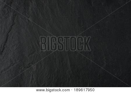 Natural black stone table top background and texture