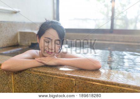 Woman enjoy japanese onsen