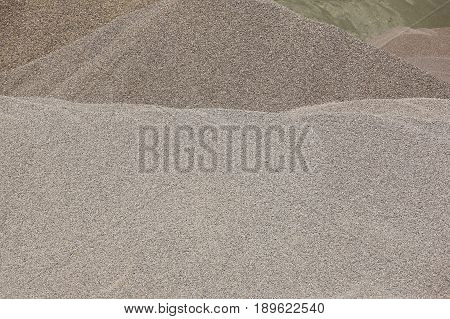 Different kinds of stone on a gravel quarry. Construction background.