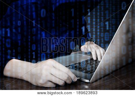 Hacker Using Keyboard Typing Bad Data Into Computer Online System And Spreading To Global Stolen Per