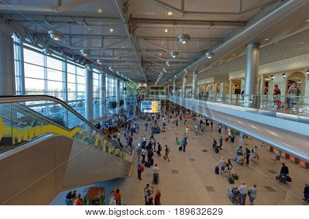 MOSCOW, RUSSIA - AUGUST 28, 2016: People in the departure terminal of Domodedovo International Airport. It is the second largest Russian airport by passenger traffic