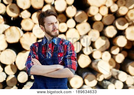 Young engineer or arborist with crossed arms