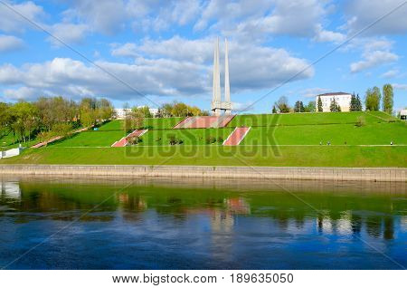 VITEBSK BELARUS - MAY 16 2017: Beautiful view of embankment of Zapadnaya Dvina river and memorial complex in honor of Soviet soldiers-liberators partisans and underground workers of Vitebsk region (
