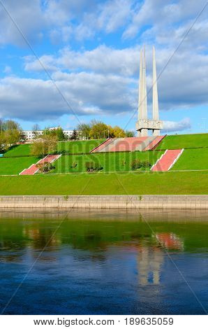 VITEBSK BELARUS - MAY 16 2017: Beautiful view of embankment of Zapadnaya Dvina river and memorial complex in honor of Soviet soldiers-liberators partisans and underground workers (