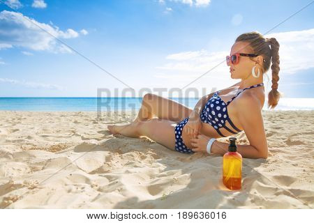 Young Woman In Swimwear On Seacoast Sunbathing