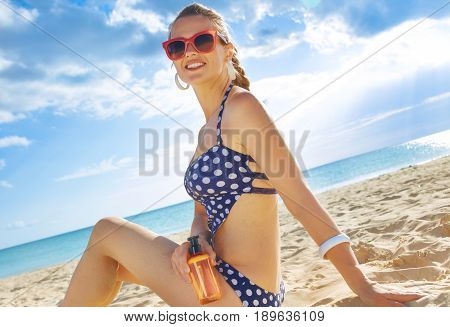 Happy Fit Woman In Swimsuit On Beach With Spf