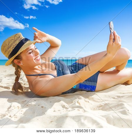 Happy Active Woman On Seacoast Taking Selfie With Mobile Phone