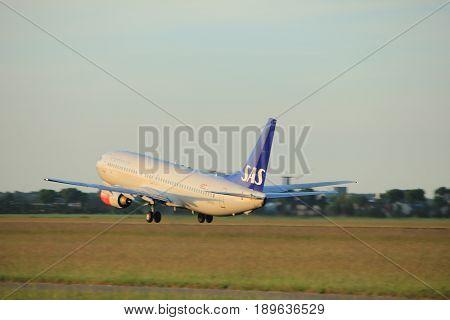 Amsterdam the Netherlands - June 1st 2017: LN-RPR SAS Scandinavian Airlines Boeing 737 taking off from Polderbaan Runway Amsterdam Airport Schiphol