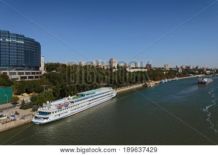 ROSTOV-ON-DON, RUSSIA - SEPTEMBER 28, 2015: River cruise ship and petroleum product tanker on the river Don. Port Rostov-on-Don is the largest transit point in the South of Russia