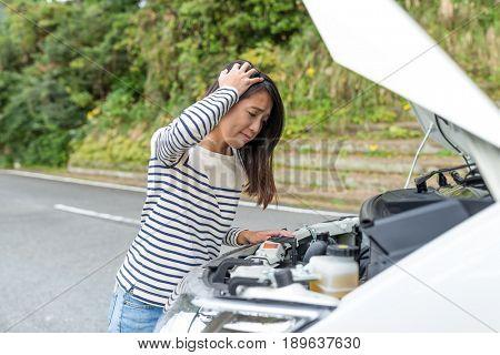 Woman having car problem at road