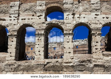 Coliseum monumental arcades with blue sky in Rome