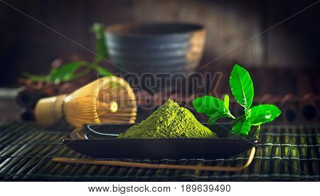 Matcha. Organic Green Matcha Tea ceremony. Matcha powder. Cooking with matcha, recipe. Vegetarian food, Japanese food. Dark still life
