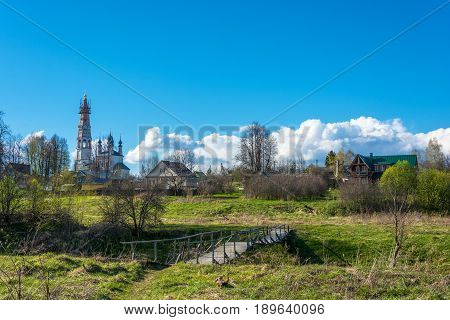 View of the village of Mikhailovskoye with views of the Church of the Holy Archangel Michael and the bodiless hosts on a Sunny spring day.