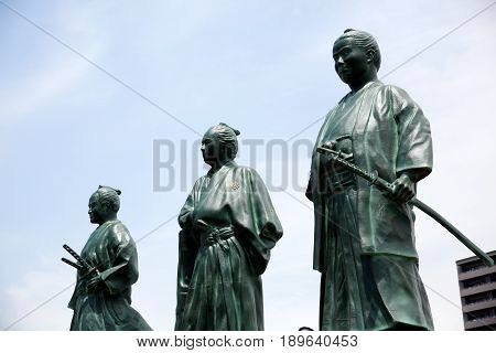 KOCHI, JAPAN - MAY 21, 2017: Statues of leaders of Bakumatsu period near Kochi railway station, Japan. Represent Sakamoto Ryoma, Takechi Hanpeita and Nakaoka Shintaro