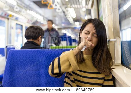 Woman feeling sick in train compartment
