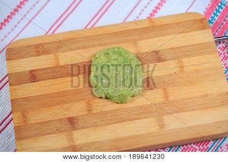 Crude Forcemeat Cutlet With A Stuffing On A Wooden Board