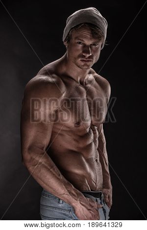 Strong Athletic Man Fitness Model  On Black Background