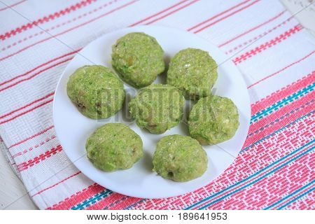 Crude Forcemeat Cutlet With A Stuffing On A Plate On A Light Background
