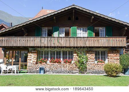 Iseltwald, Switzerland - 24 September 2016: Rural chalet of Iseltwald in Jungfrau region near lake Brienz on Switzerland