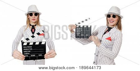 Beautiful girl in striped clothing holding clapperboard isolated