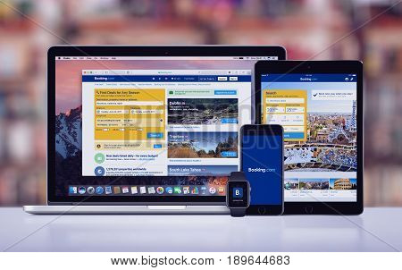 Varna, Bulgaria - May 23, 2017: Booking.com hotels search page on the Apple MacBook Pro, Booking.com app on iPad Pro, Booking splash screen with logo on iPhone 7 and notification icon on Apple Watch.