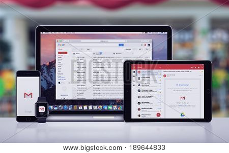 Varna, Bulgaria - May 23, 2017: Google Gmail page on the Apple MacBook Pro, Gmail app on iPad Pro, Gmail splash screen with logo on iPhone 7 and notification icon on Apple Watch. Office desk concept.