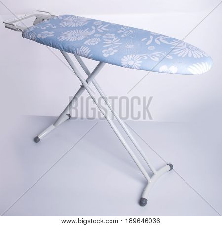 Ironing Board Or Ironing Tool On A Background.