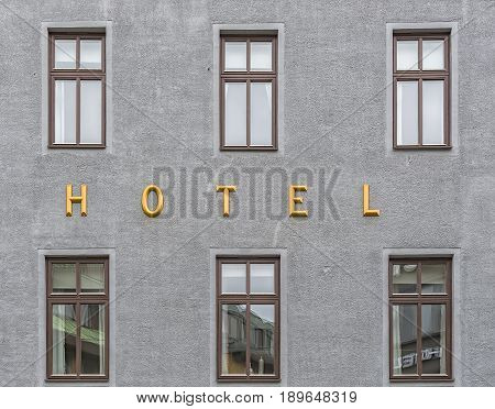 A hotel sign situated next to the room windows