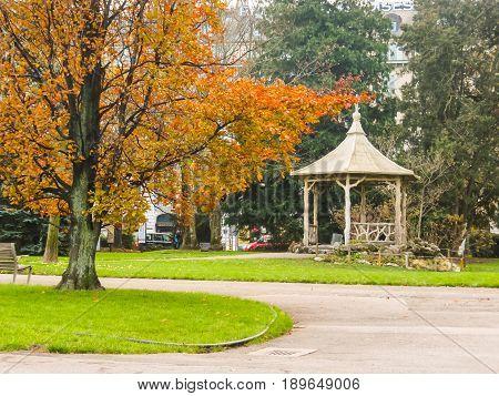 GENEVA, SWITZERLAND - DECEMBER 5, 2013: Jardin Anglais English-inspired landmark park with Lake Geneva views. Geneva city, Switzerland