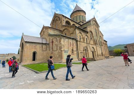 Mtskheta, Georgia - April 28, 2017: Peole near Svetitskhoveli Cathedral located in the historical town of Mtskheta, Georgia