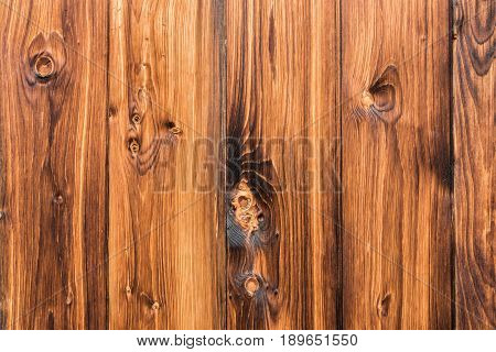 Natural brown barn wood wall. Wooden wall with organic texture background pattern. Wood planks, boards are old with a beautiful rustic look, style.