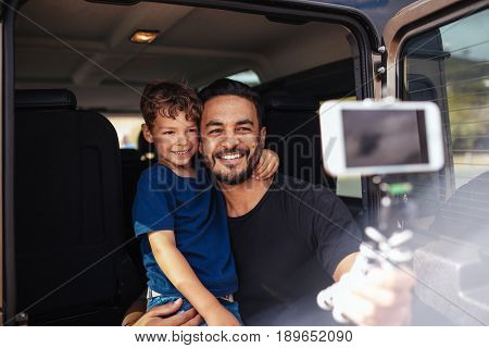 Father And Son On Road Trip Taking Selfie