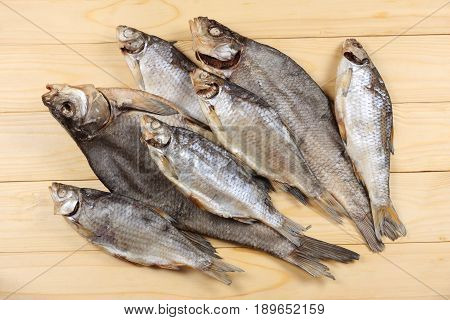 Dried fish on the table. Salty dry river fish on a light wooden background.top view with copy space