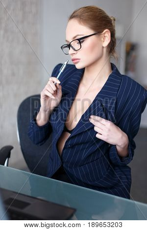Sexy smart secretary online flirting in office