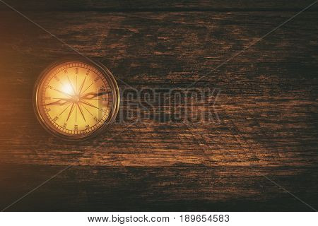 Vintage Compass on the Reclaimed Wood. Travel and Journey Concept Background. Right Side Copy Space.