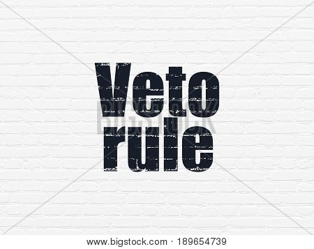 Political concept: Painted black text Veto Rule on White Brick wall background