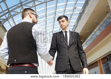 Handshaking employer and new staff after interview