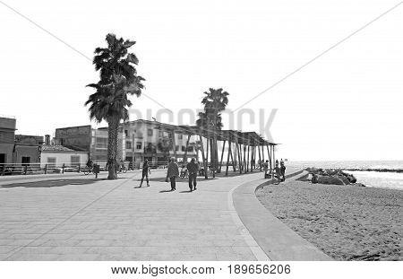 People On The Seaside Boardwalk